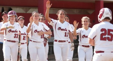 Steph Pasquale (25) is greeted by her Temple teammates after hitting a home run in 2011. (Courtesy of Philly.com)
